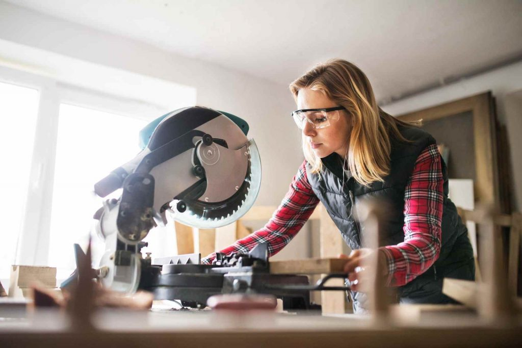 woman working with a miter saw